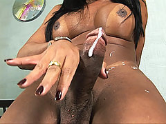 Big cock black tranny shoots a load