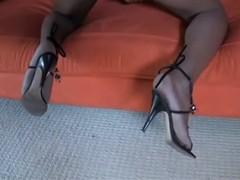 Beautiful black tranny poses on sofa