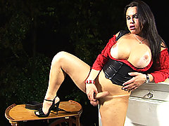 Busty tgirl beauty Leticia Brunni striptease