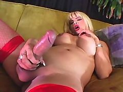 Saucy shemale in high boots wanking