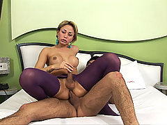 Blonde ts in purple pantyhose rides a cock