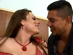 TS in red stockings getting blowjob