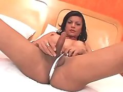 Winsome shemale masturbates on bed